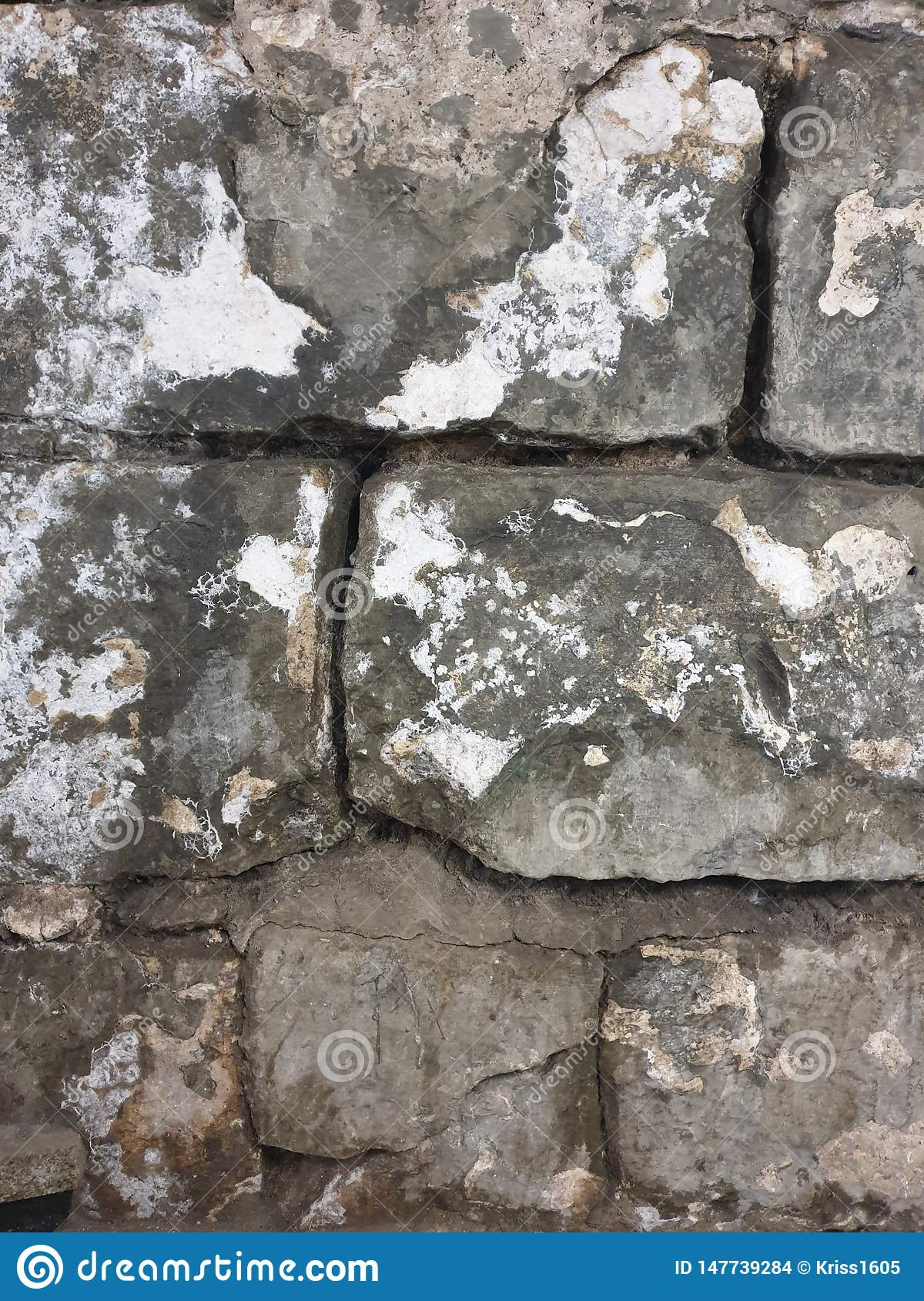 Texture of large old grey bricks