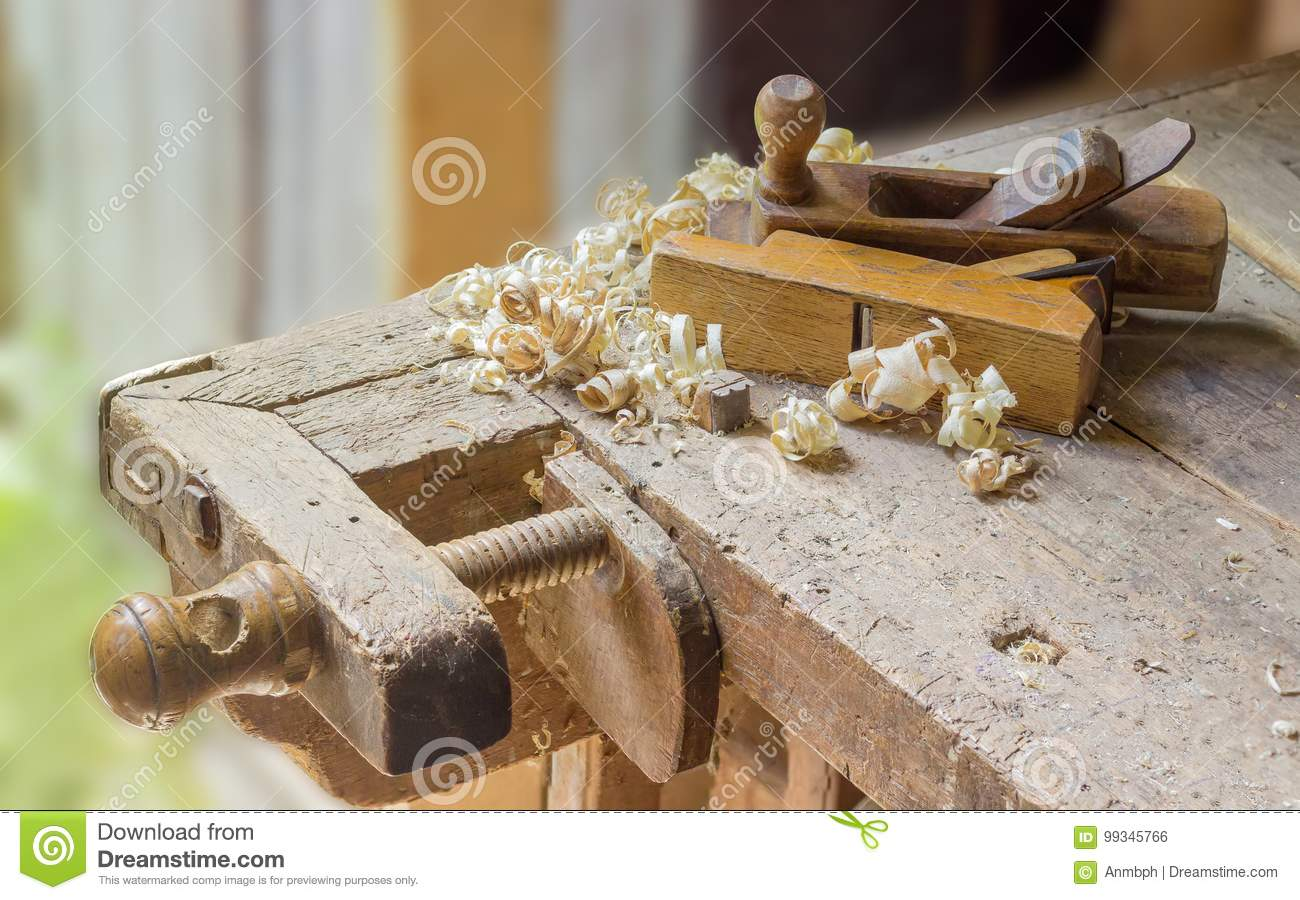 Fragment Of Old Woodworking Workbench With Two Wooden Hand