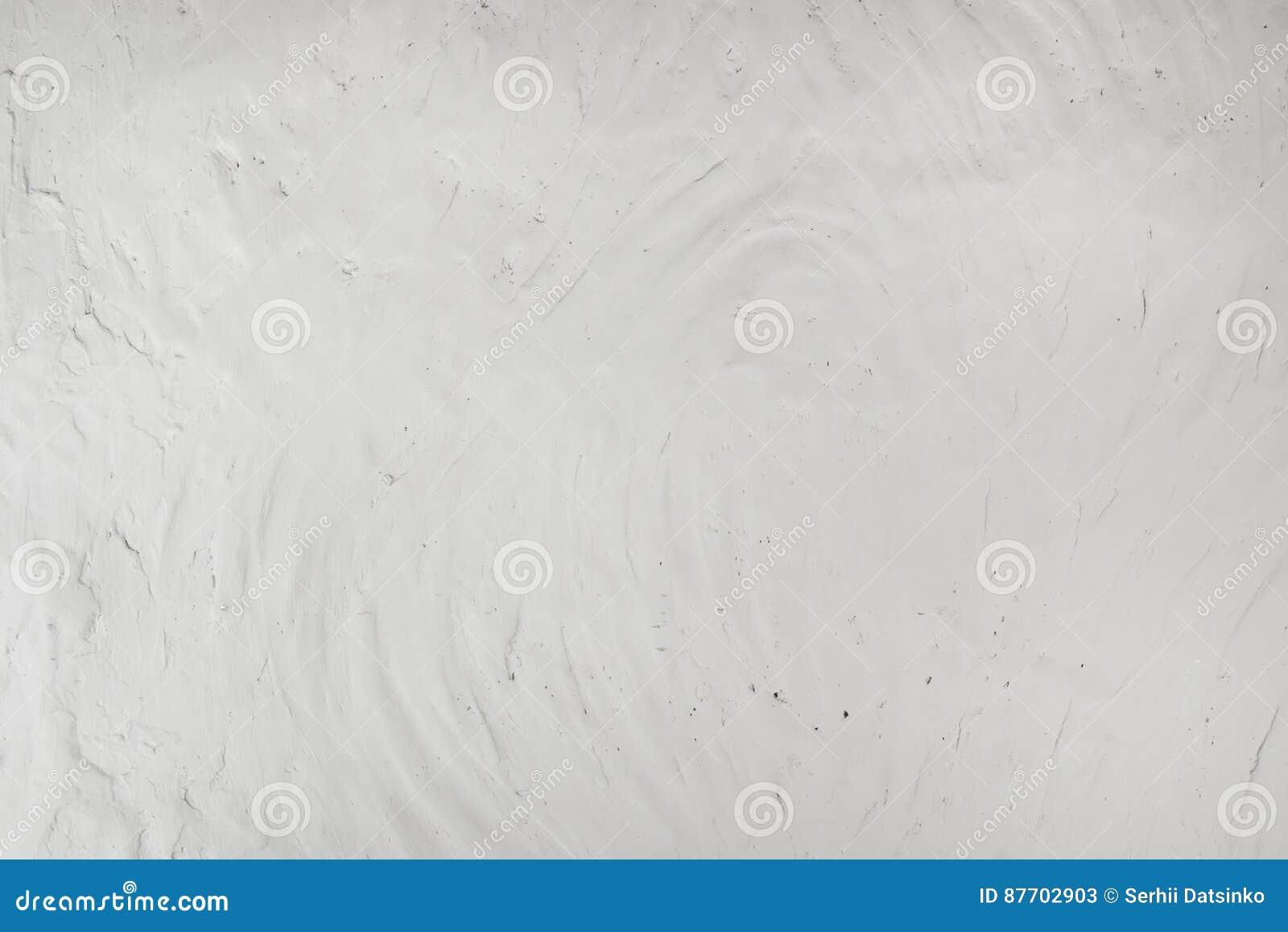 Fragment ou texture blanc de fond de mur de stuc