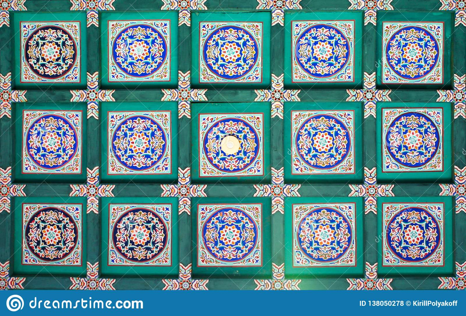 A fragment of the traditional pattern on the ceiling of the Long Corridor of the most interesting sights of the Summer Palace in B