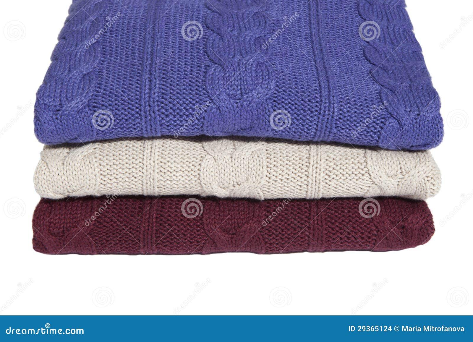 Fragment van drie gevouwen sweaters