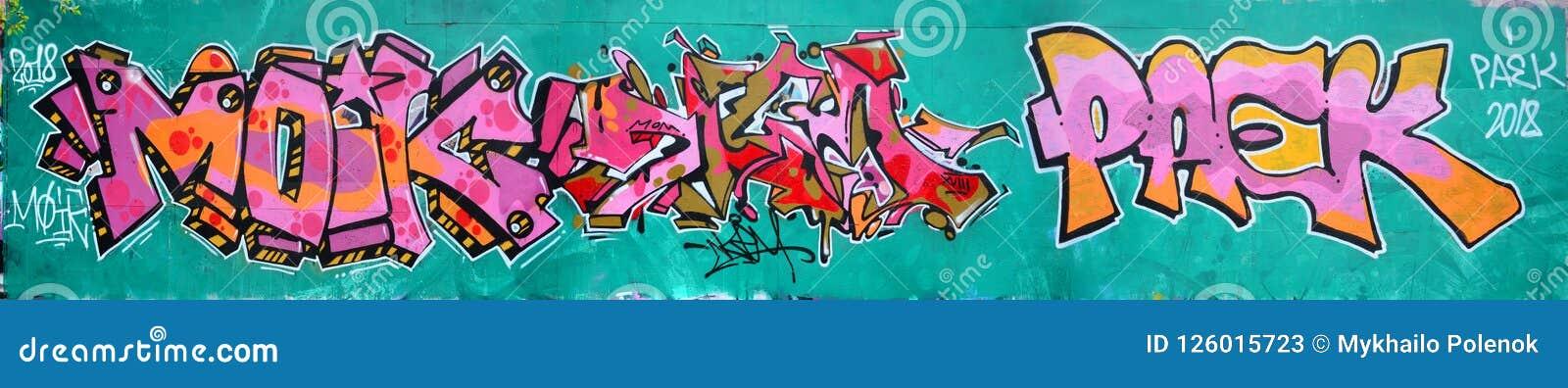 Fragment van een mooi graffitipatroon in roze en groen met