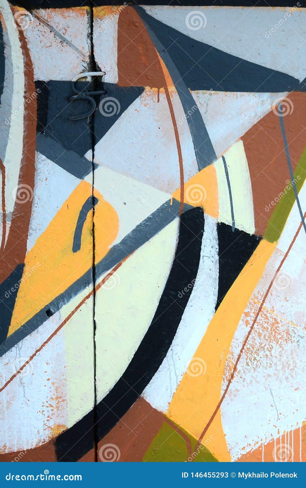Fragment van gekleurde de graffitischilderijen van de straatkunst met contouren en dicht omhoog het in de schaduw stellen