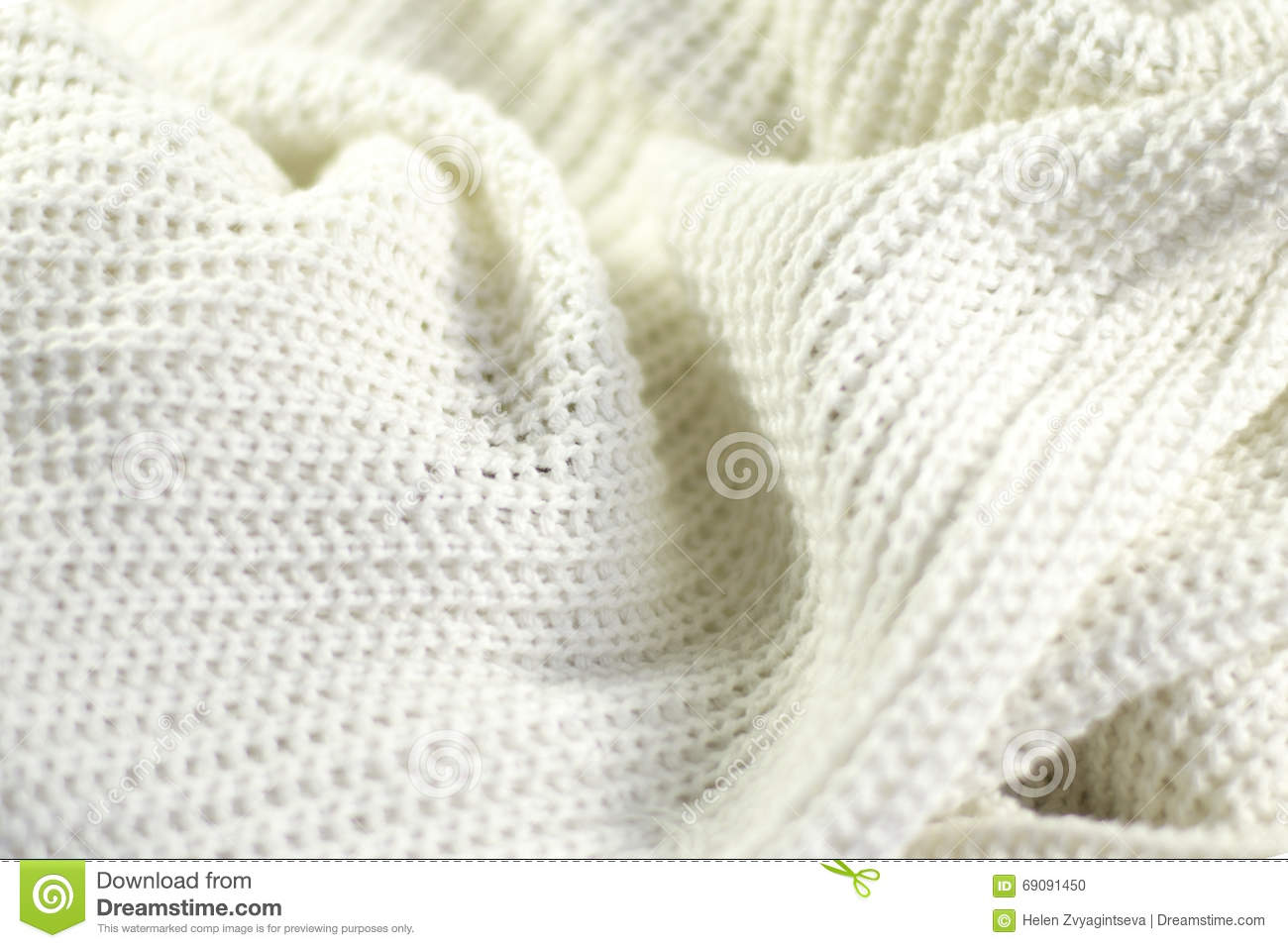 Fragment of a wrinkled knitted white