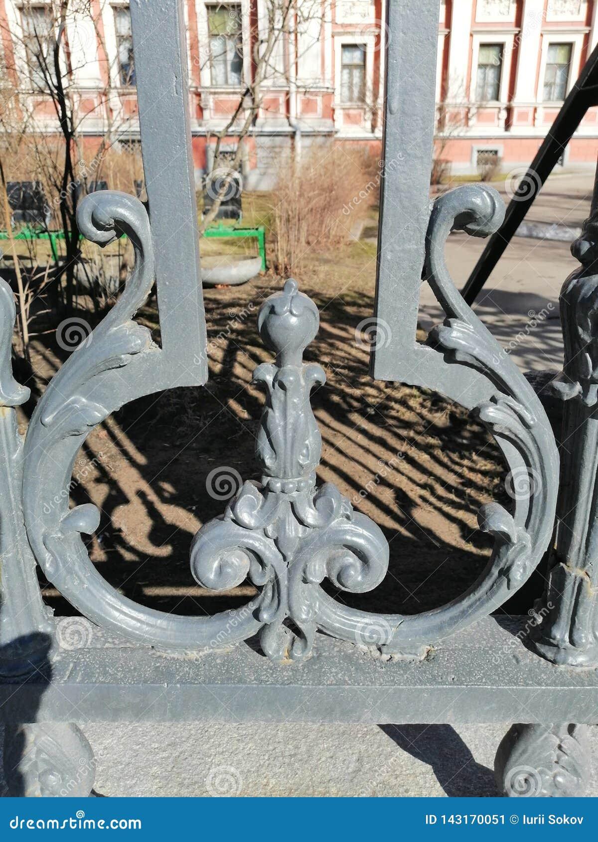 Fragmento da cerca velha do metal