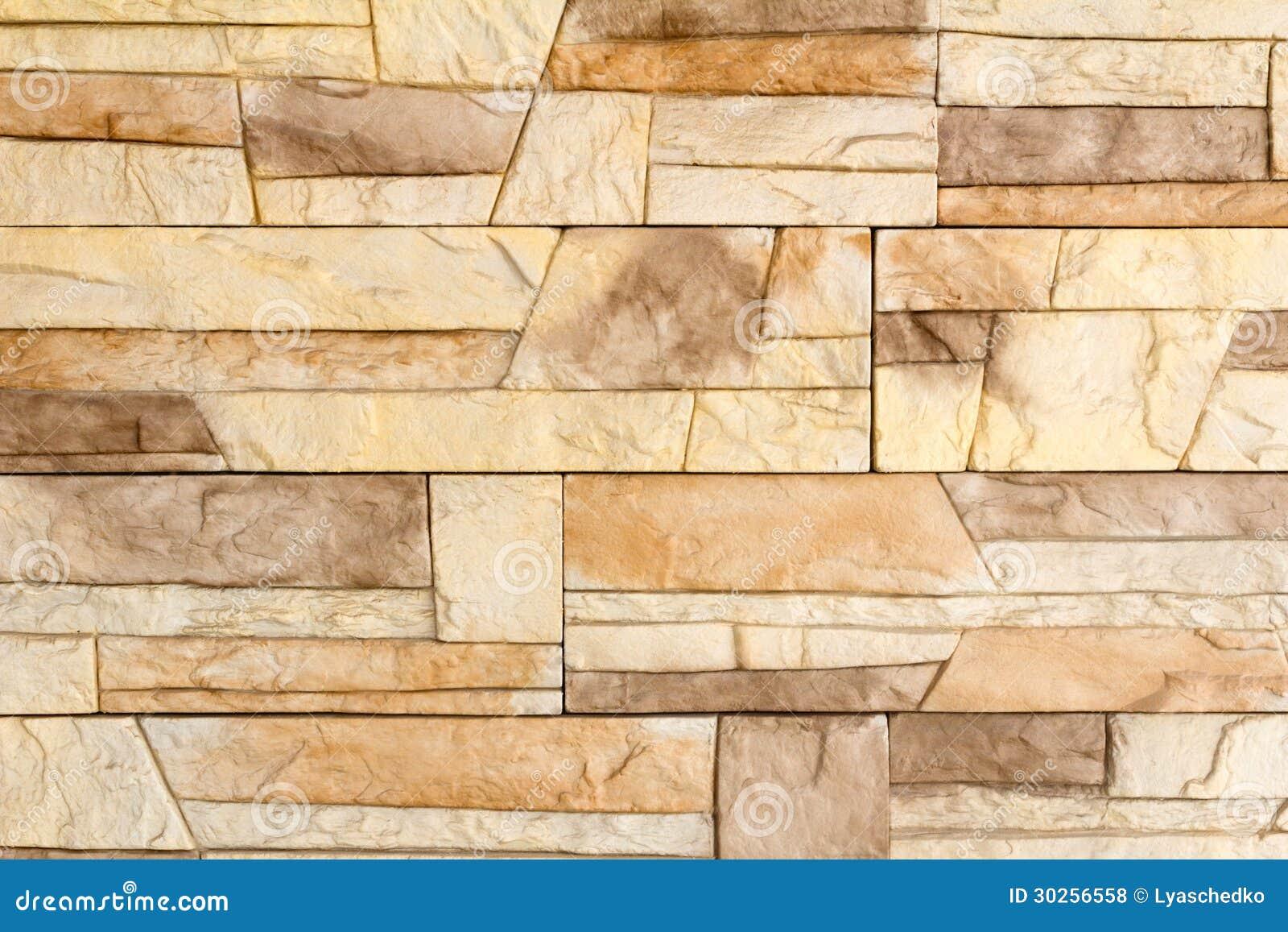 Fragmento da parede coberta com uma telha imitando um st - Paredes imitacion piedra ...
