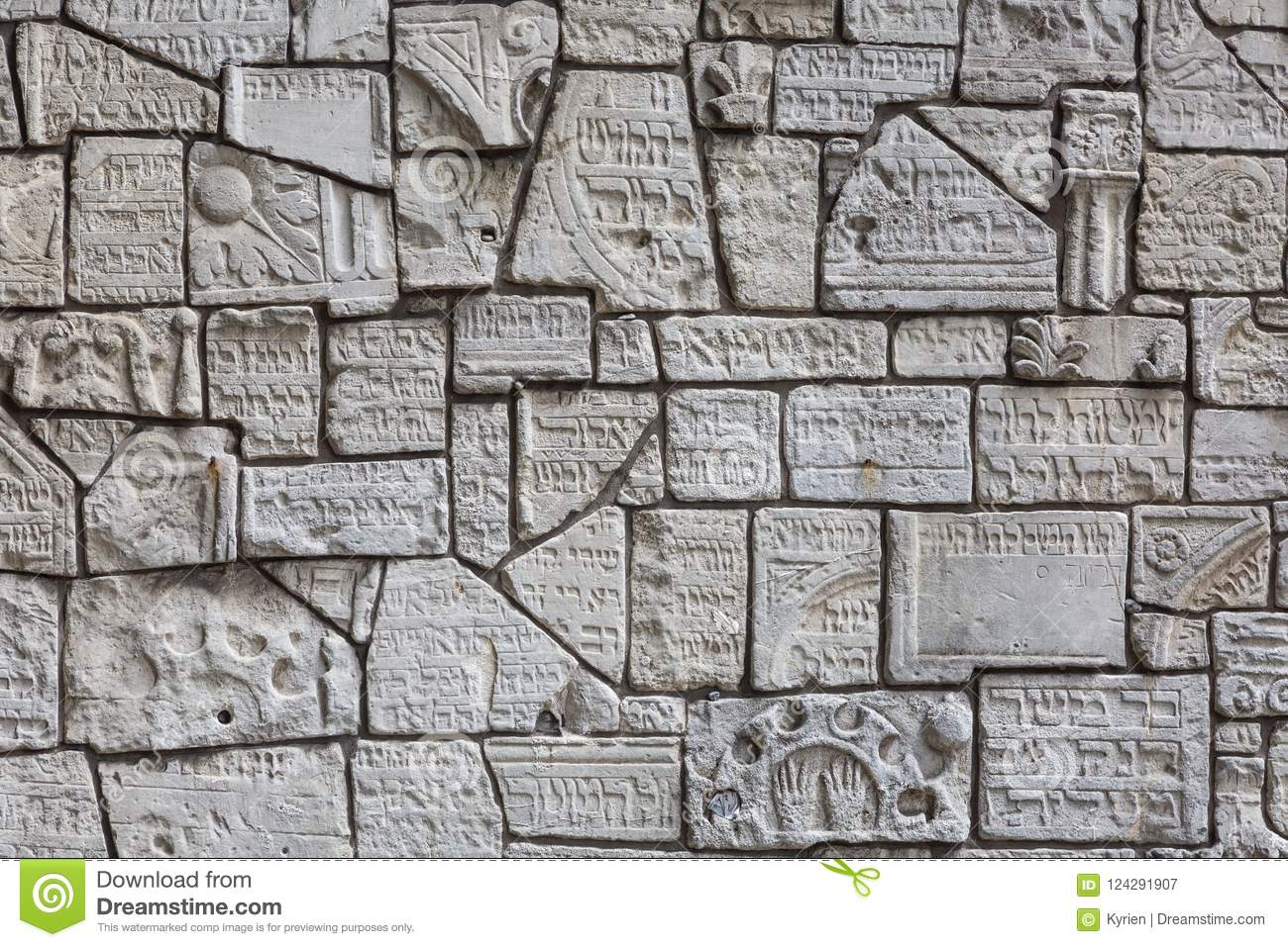 Fragments of jewish tombstones on a wall in the jewish cemetery