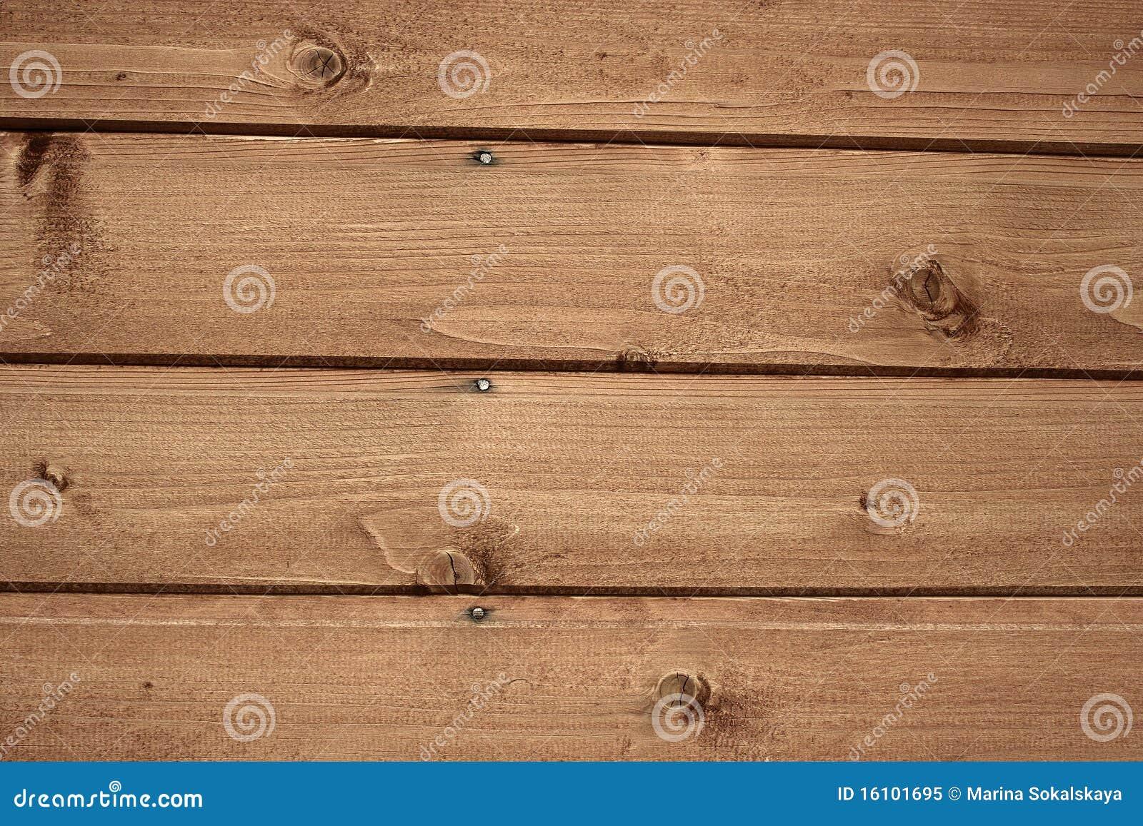 Fragnent da parede de madeira com pregos