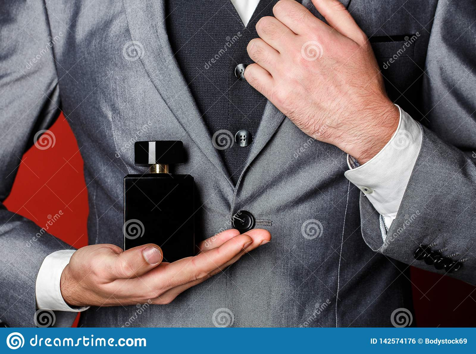 Fragrance smell. Male fragrance, perfumery, cosmetics. Smell perfume. Expensive suit. Rich man prefers expensive
