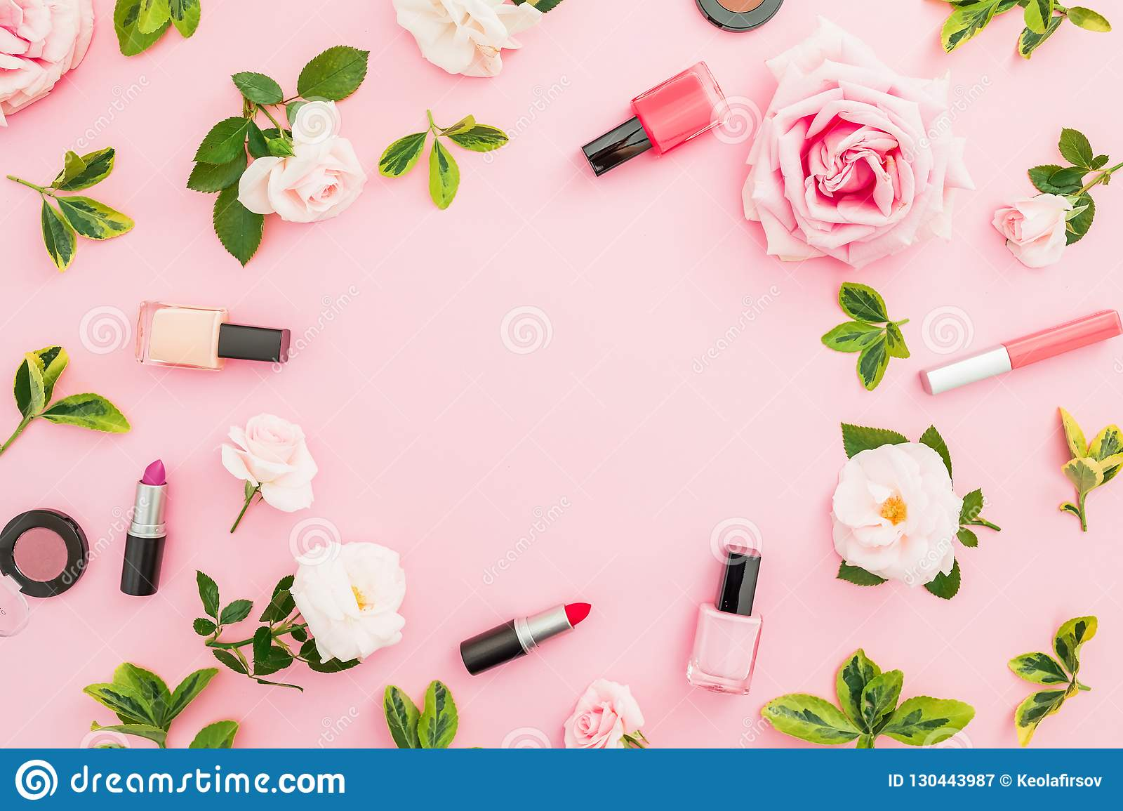 Frame Composition With Roses And Makeup Cosmetics On Pastel Pink