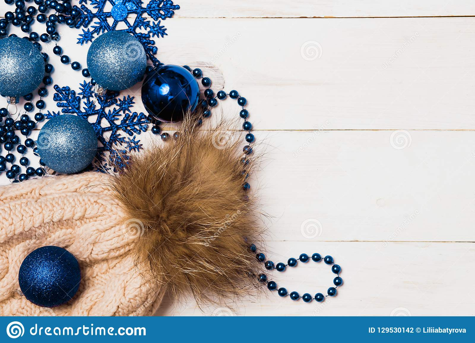 Frame made of christmas decoration with christmas glass balls, tinsel, bow. christmas wallpaper. flat lay, top view