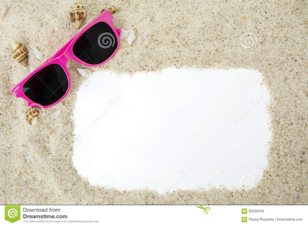 Frame with sand and sunglasses