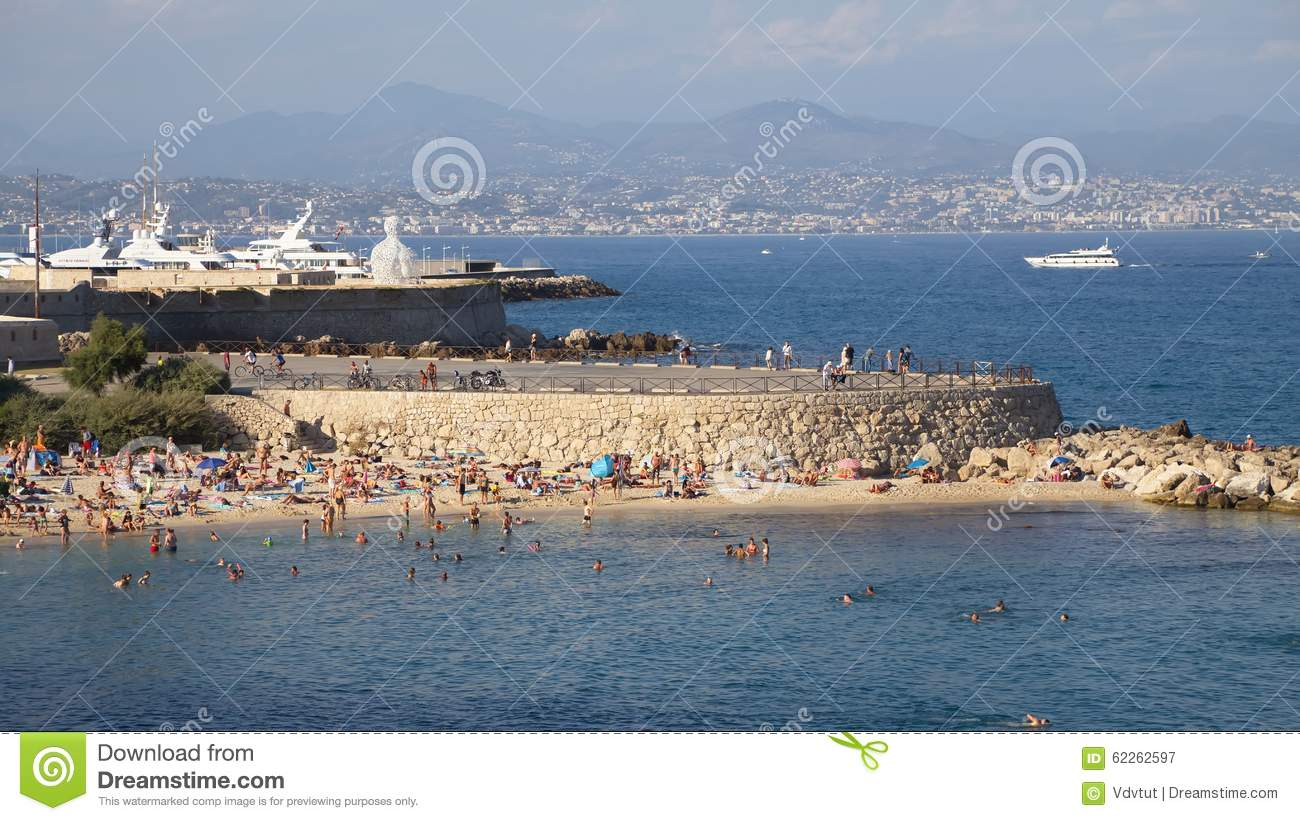 france antibes august 28 warm sea beach busy day in antibes editorial photography image. Black Bedroom Furniture Sets. Home Design Ideas