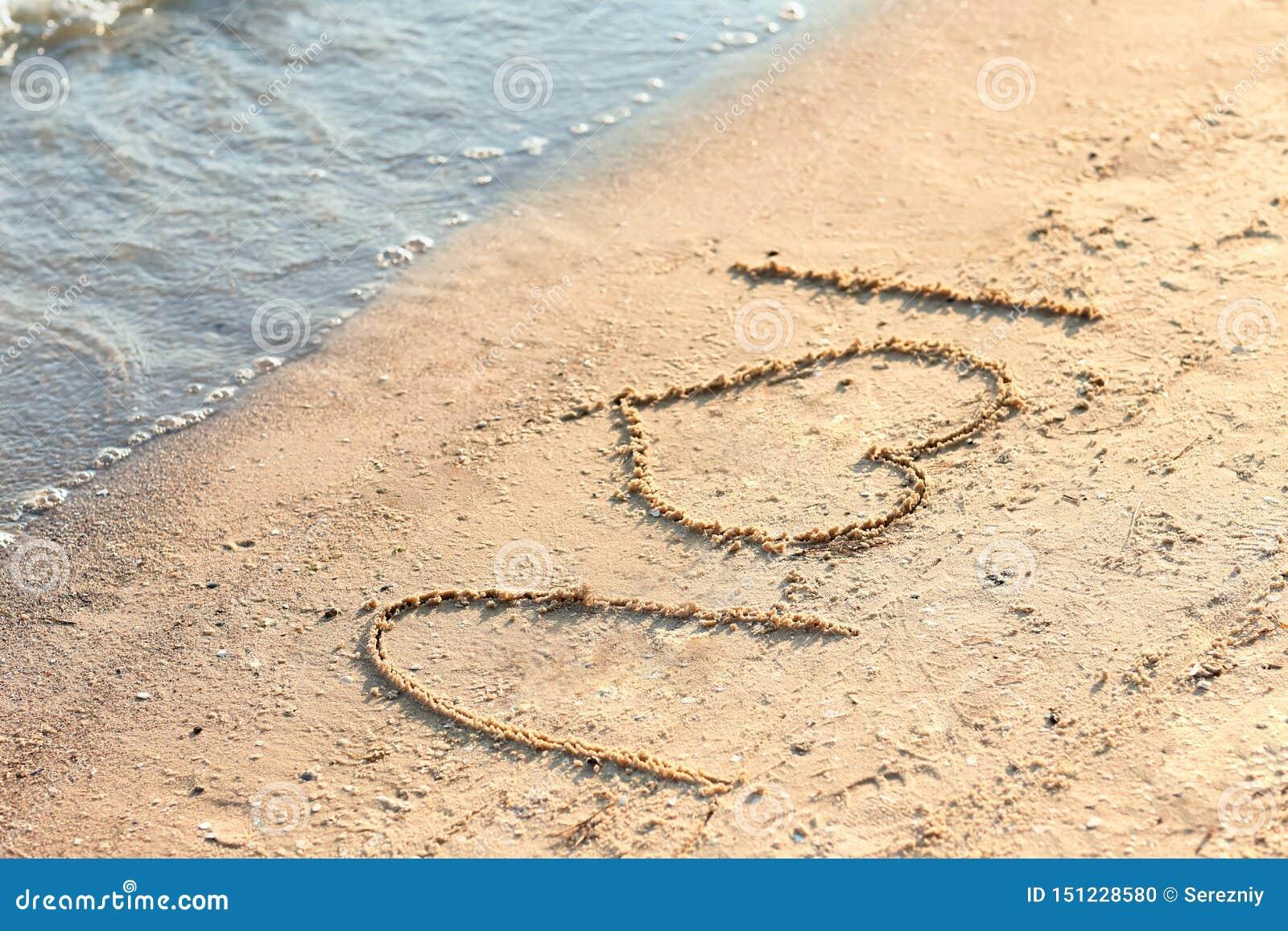 Frase Te Amo Escrita En La Arena De La Playa Foto De Archivo
