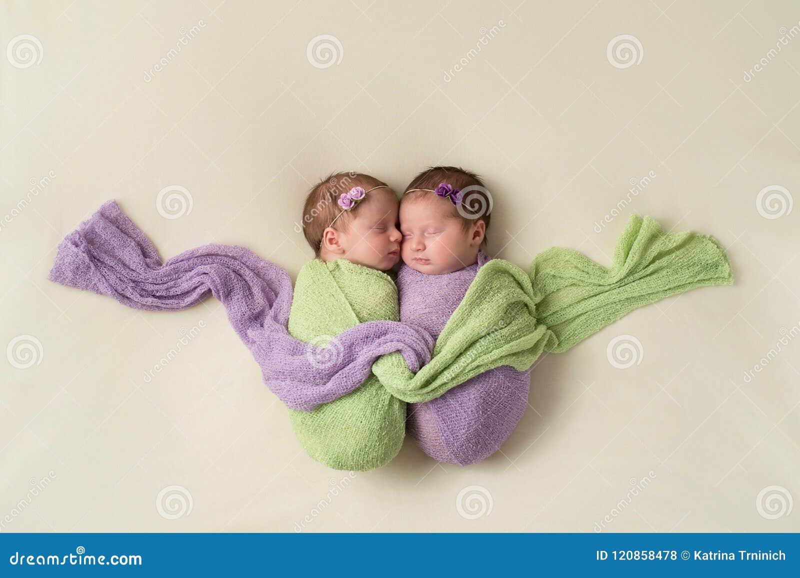 Fraternal Twin Newborn Girls in Swaddles