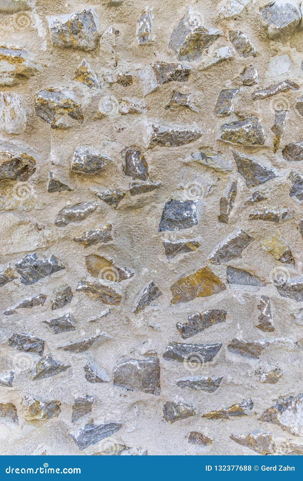 Muro Fatto In Pietra frattura di un muro di cinta storico fatto della pietra