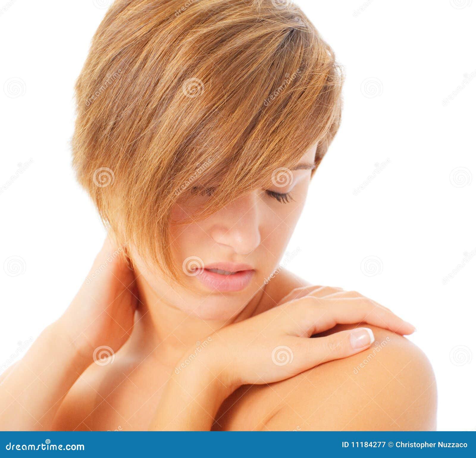 Frau, die sich massiert stockbild. Bild von nahaufnahme