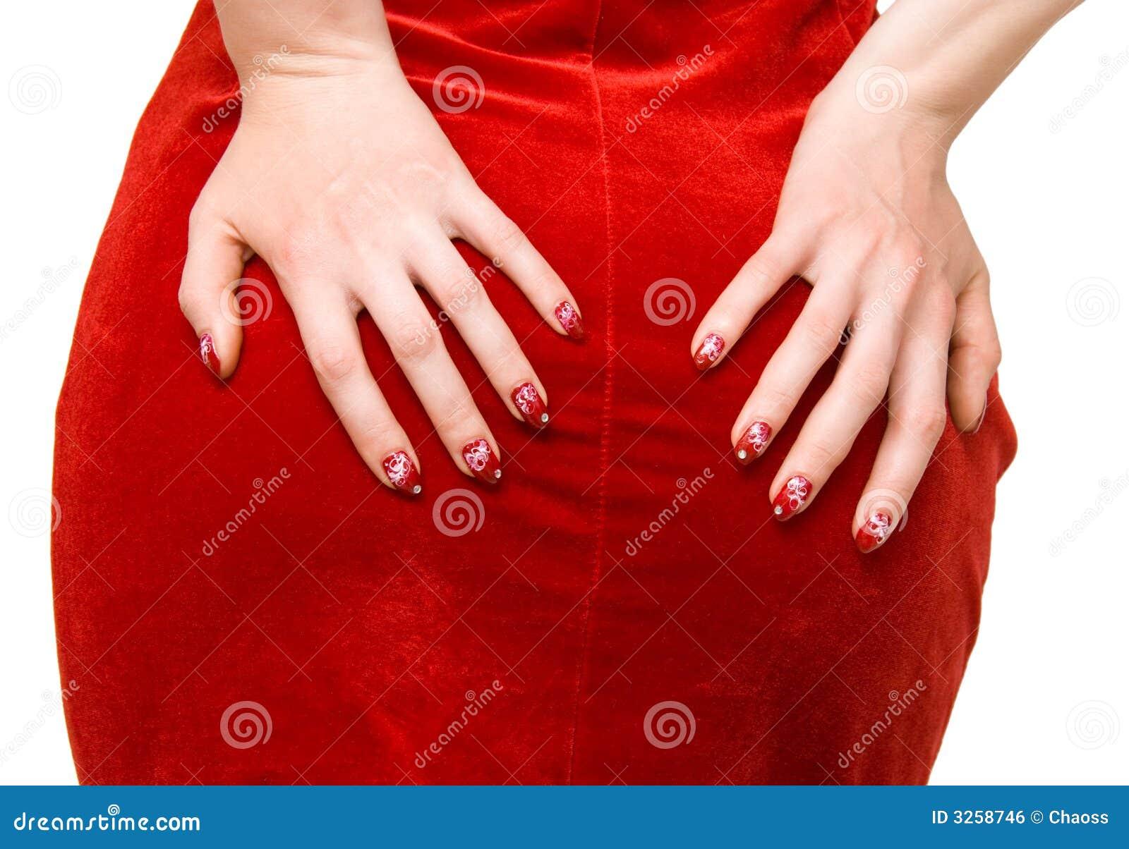 frauenhände auf rotem kleid stockfoto - bild von rotem