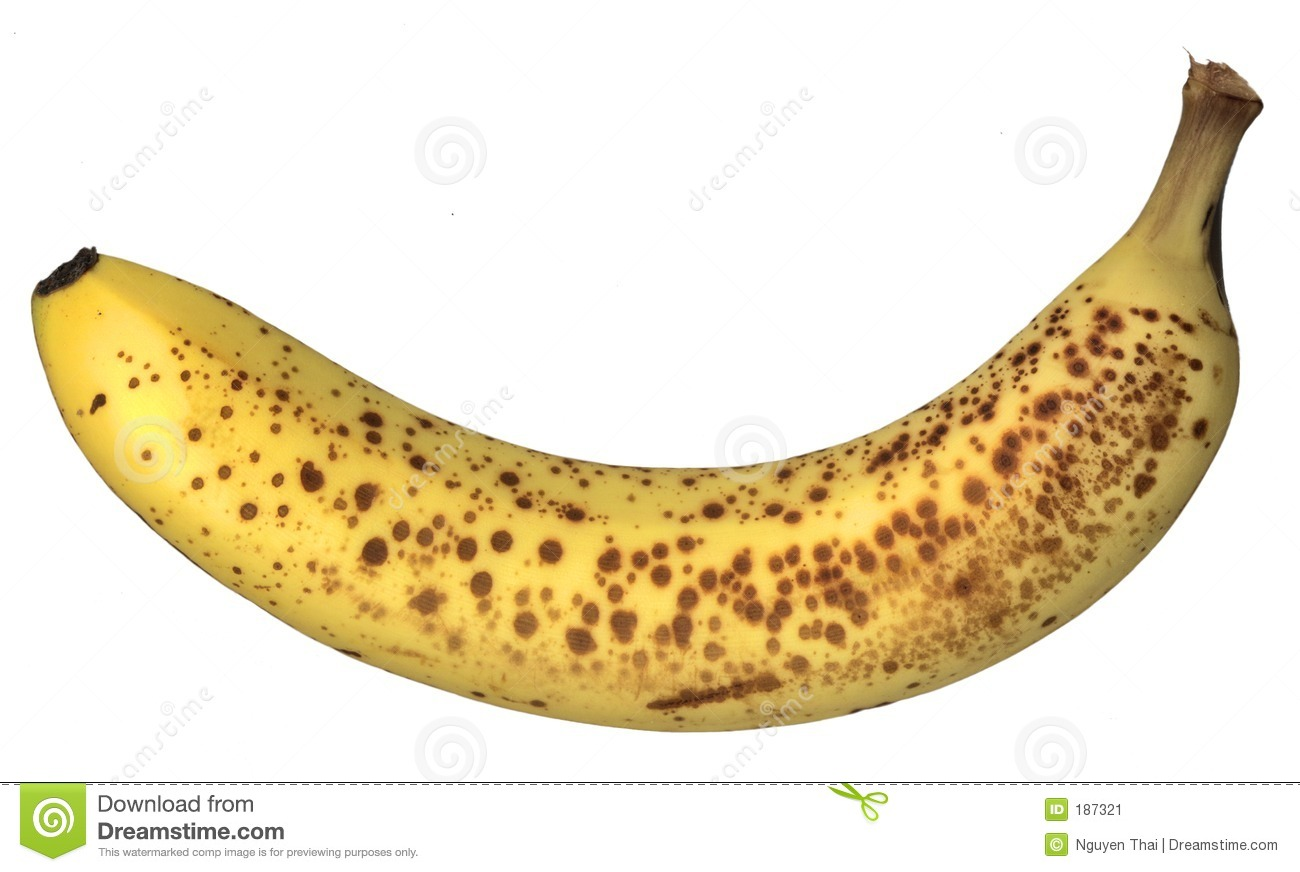 ripe banana with freckled skin, isolated on white.
