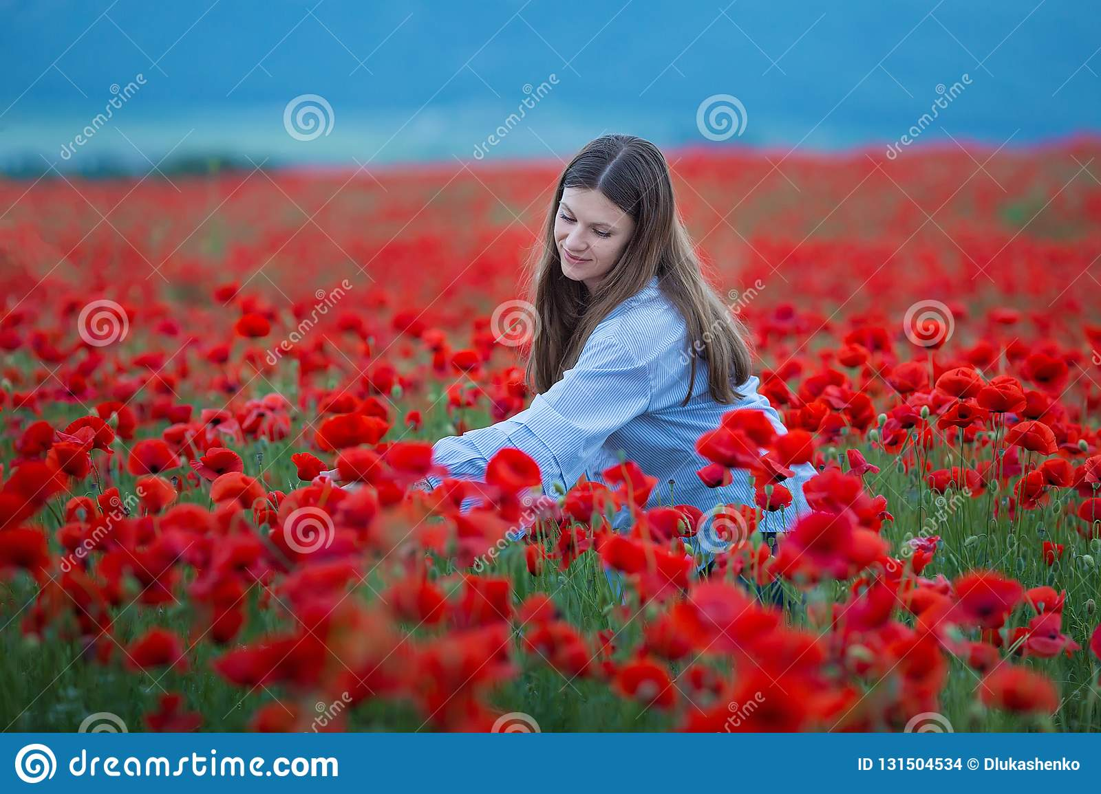 Free Happy Woman Enjoying Nature. Beauty Girl Outdoor. Freedom concept. Beauty Girl over Sky and Sun. Sunbeams. Enjoyment