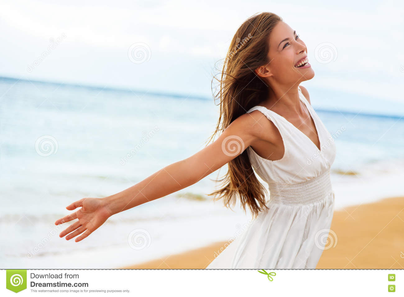 Free happy woman open arms in freedom on beach