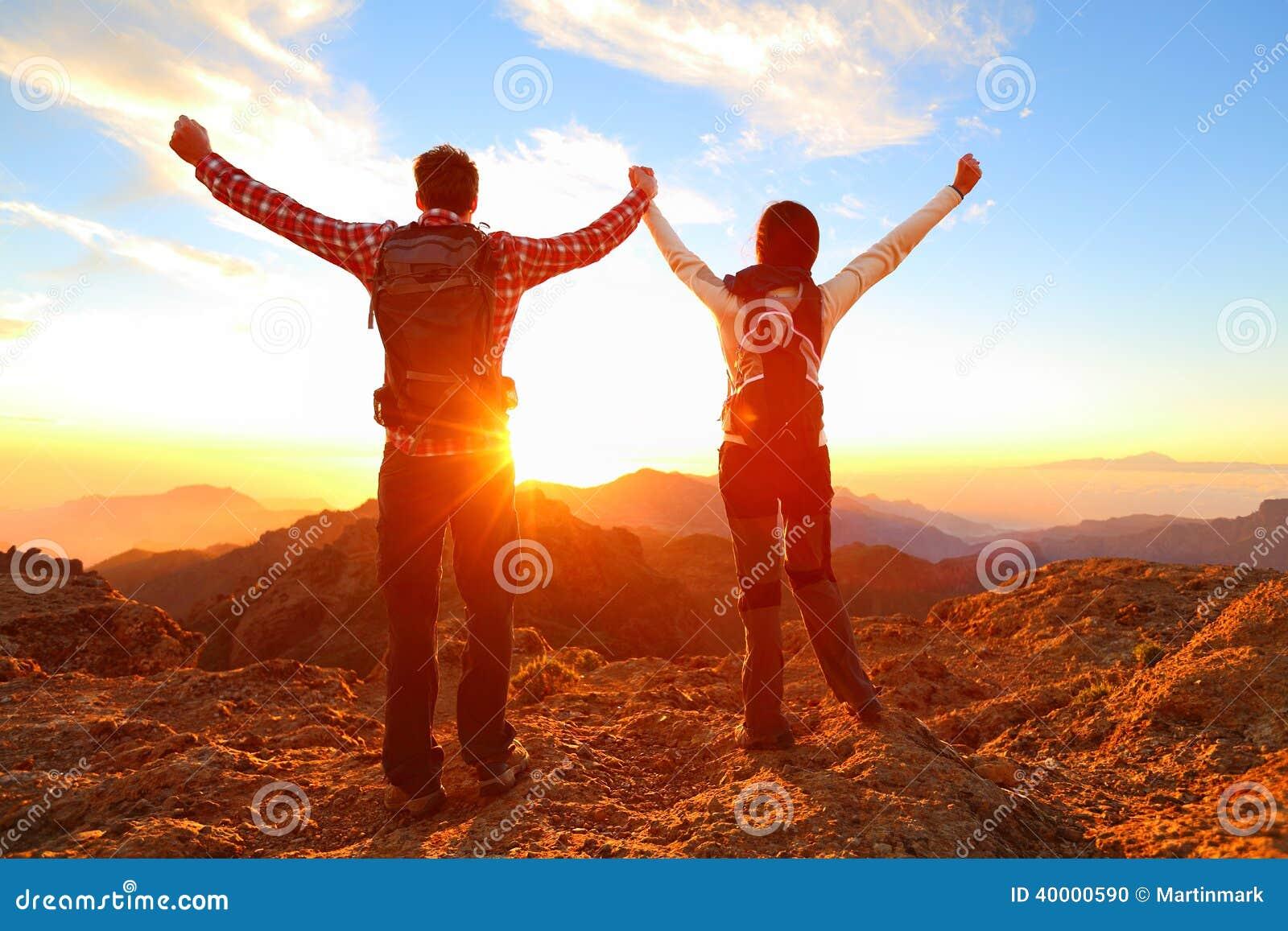 Freedom - Happy couple cheering and celebrating
