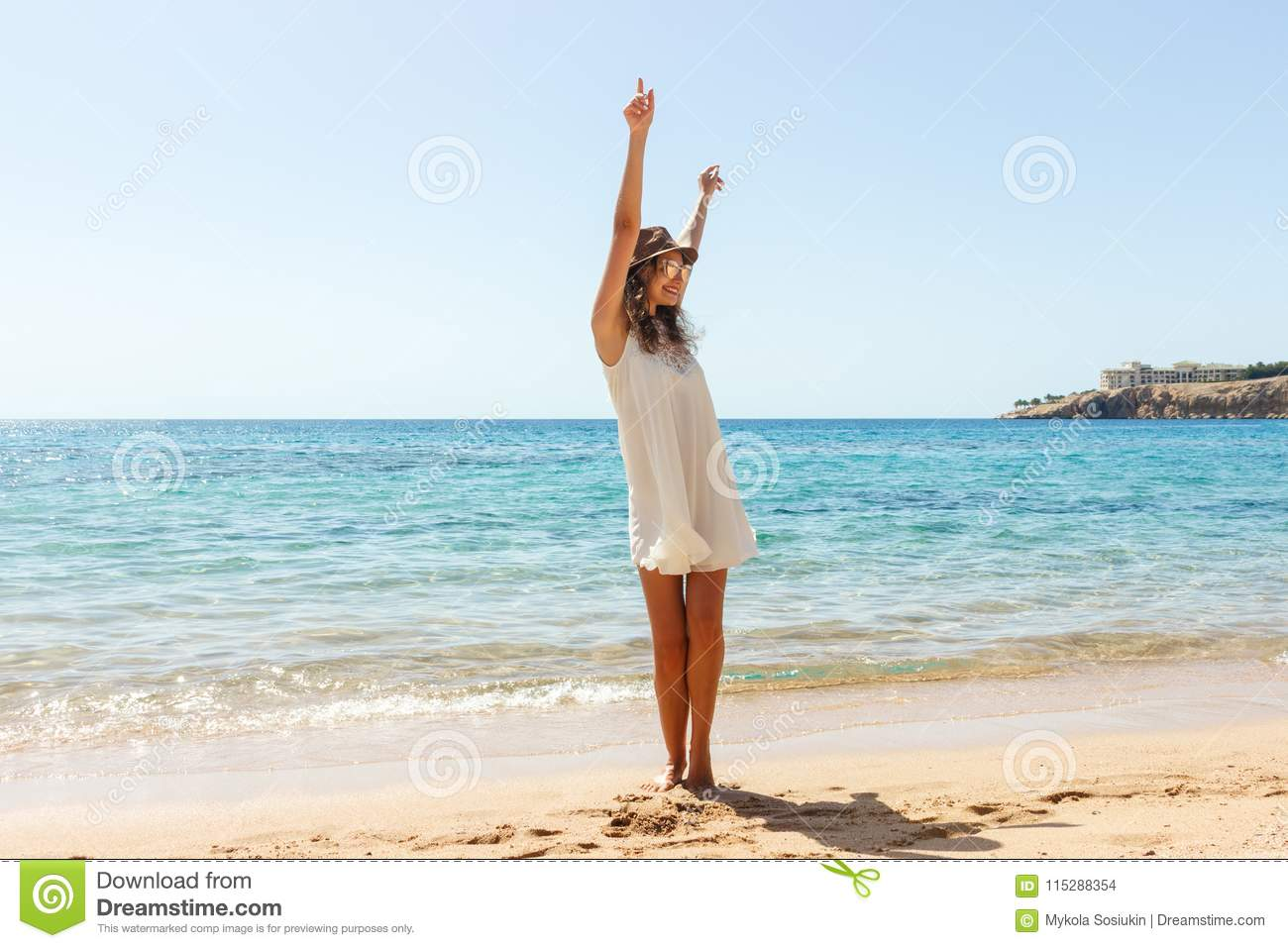 Freedom woman in free happiness bliss on beach. Smiling happy girl in white summer dress in vacation outdoors