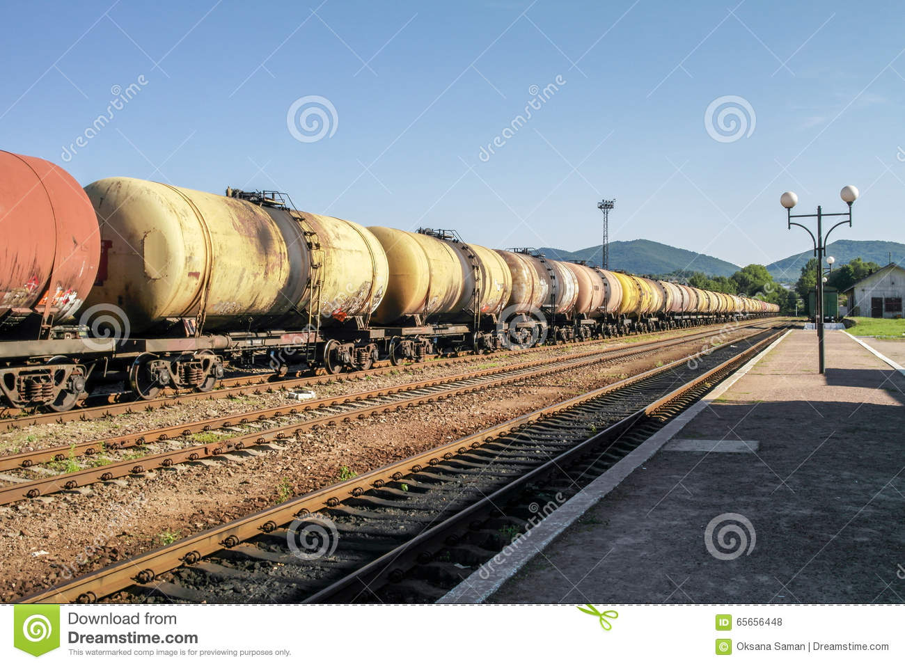 Freight trains.Railroad train of tanker cars transporting crude oil on the tracks