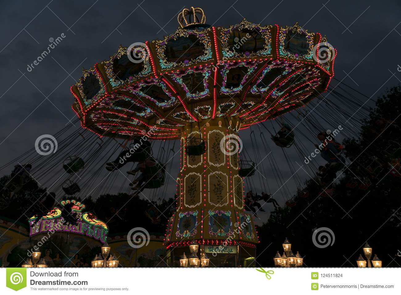 Freimarkt, Bremen,Germany, April 14th, 2017: Fast ride on an illuminated chairoplane with high flying chairs