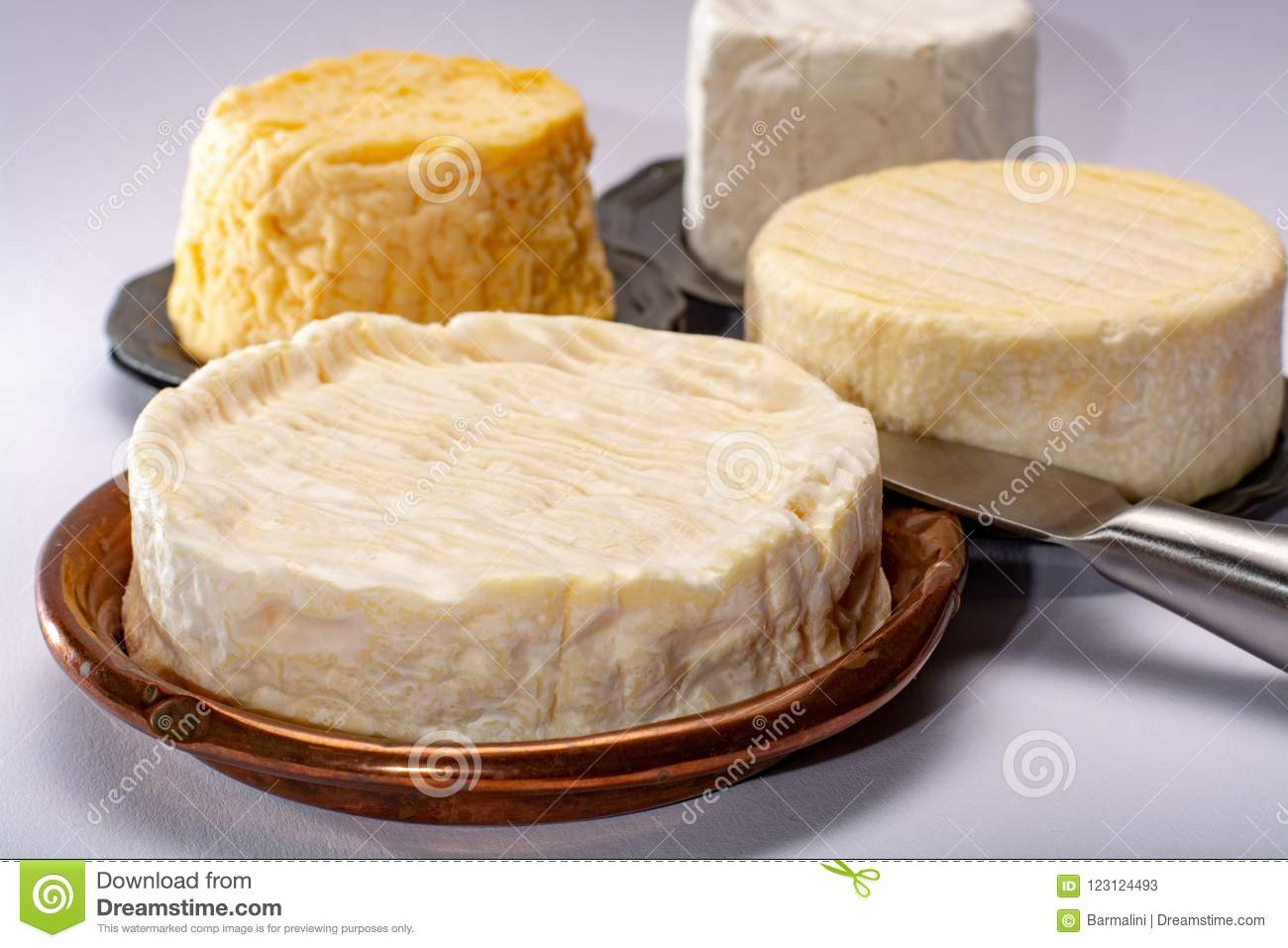 French AOC soft cow cheeses, crumbly Langres with washed rind st