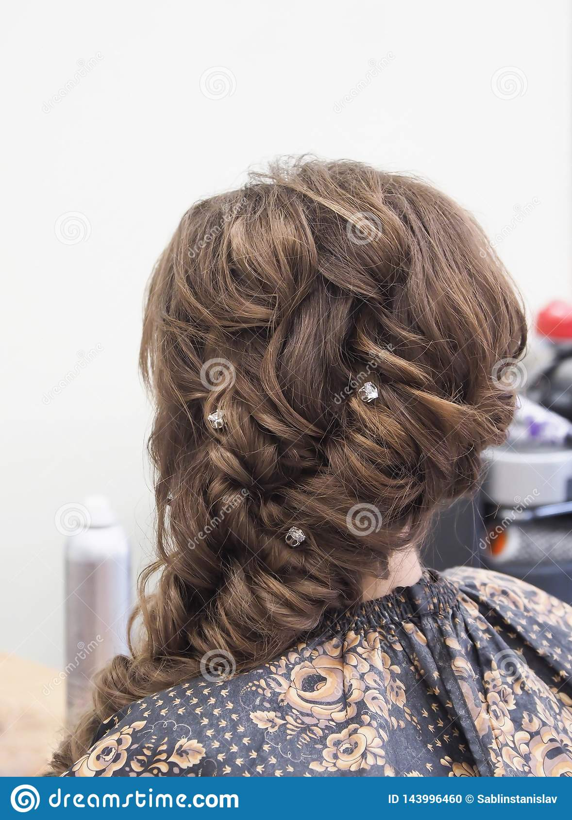 French braid with jewelry. Hairstyle with jewelry.