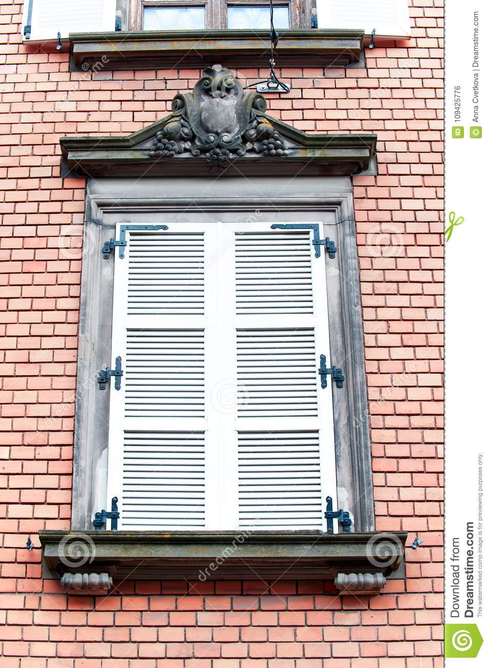 French Classic Style Window With Wooden Shutters On Red