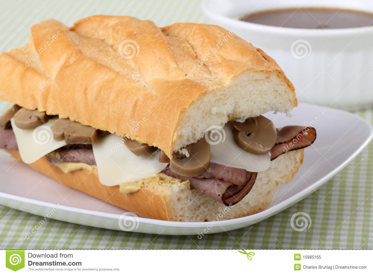 French dip made with roast beef, mozzarella cheese, mushrooms on ...