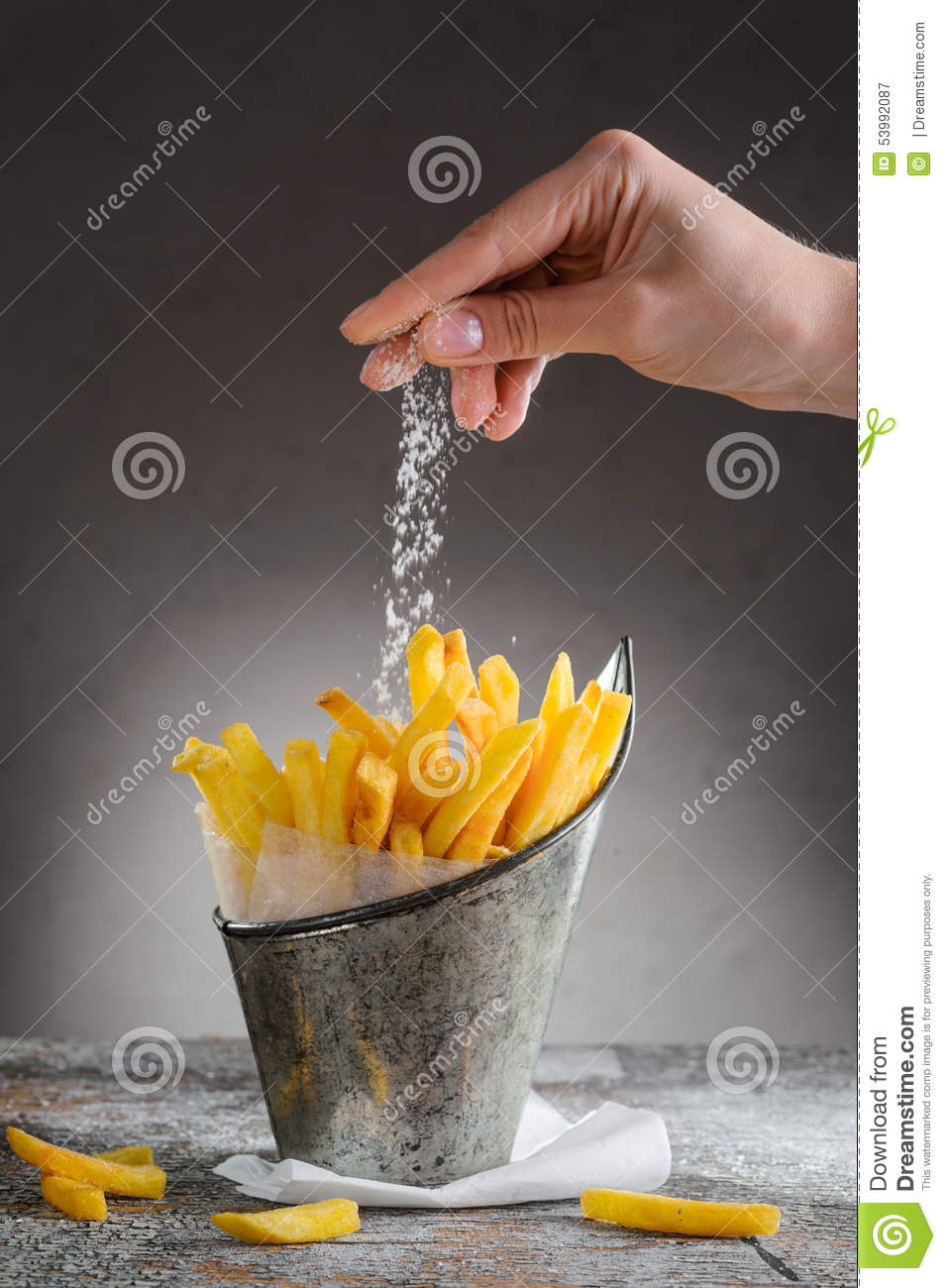 French Fries Sprinkled With Salt In An Iron Bucket Stock ...