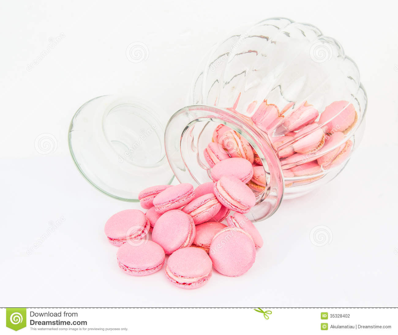 Pink French macaron in a glass jar with vanilla buttercream filling.