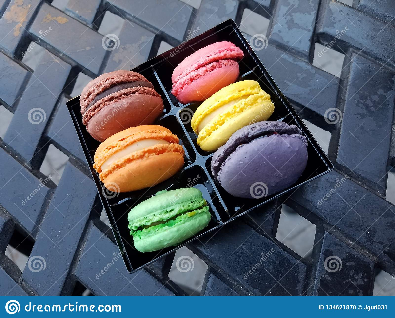 French Macroons from Local Patisserie on a Patio Table