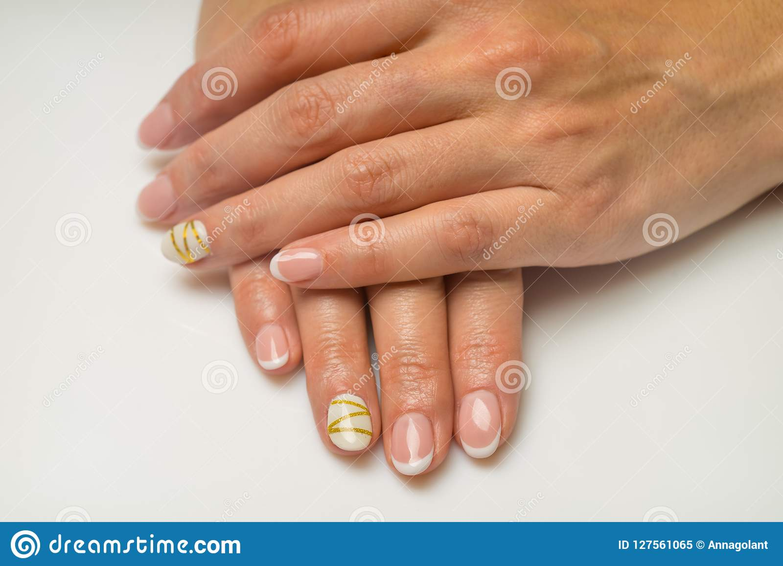French Manicure And Nail Gel Polish. The Decoration Of The Nail ...