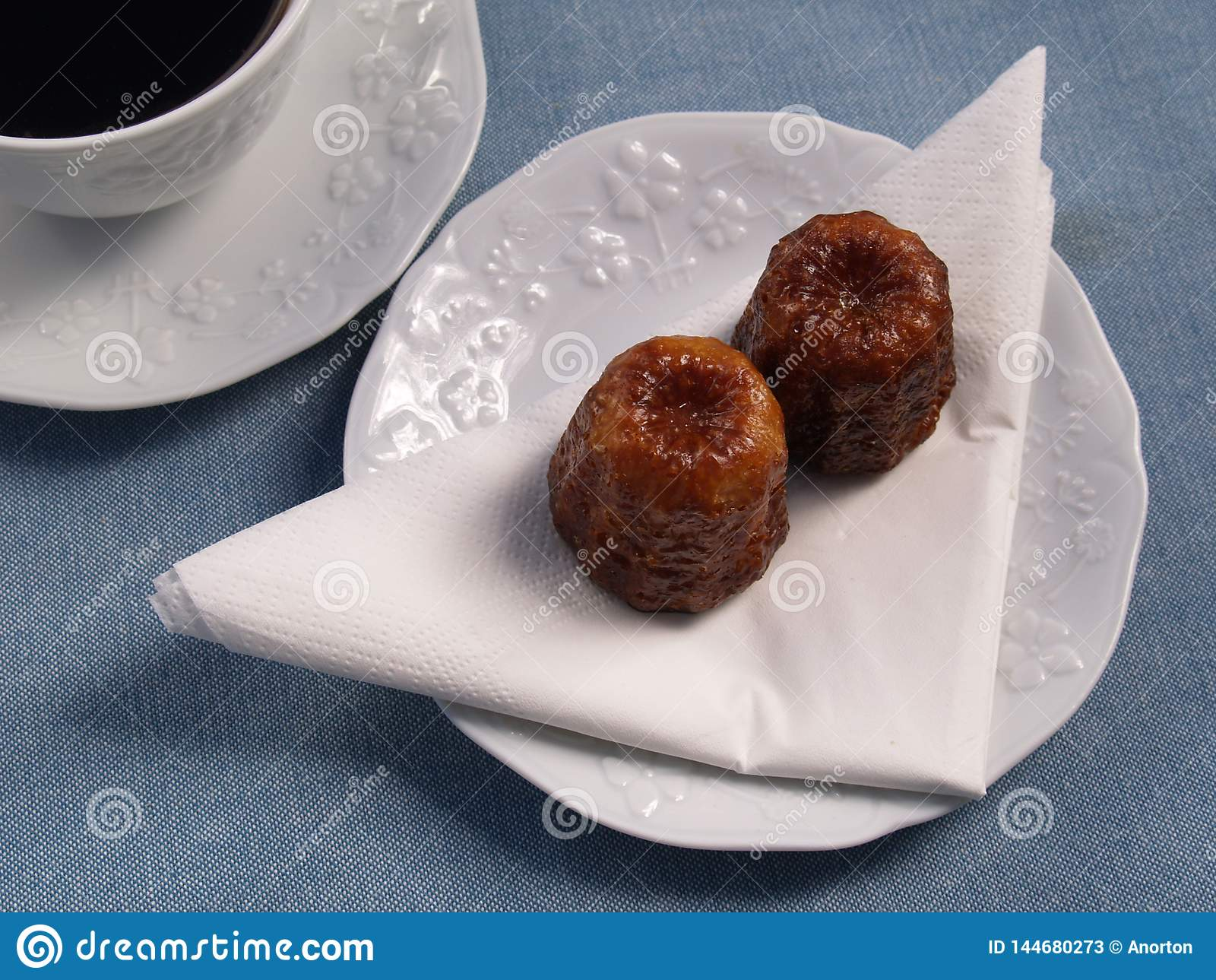 Traditional French cakes canelé with coffee