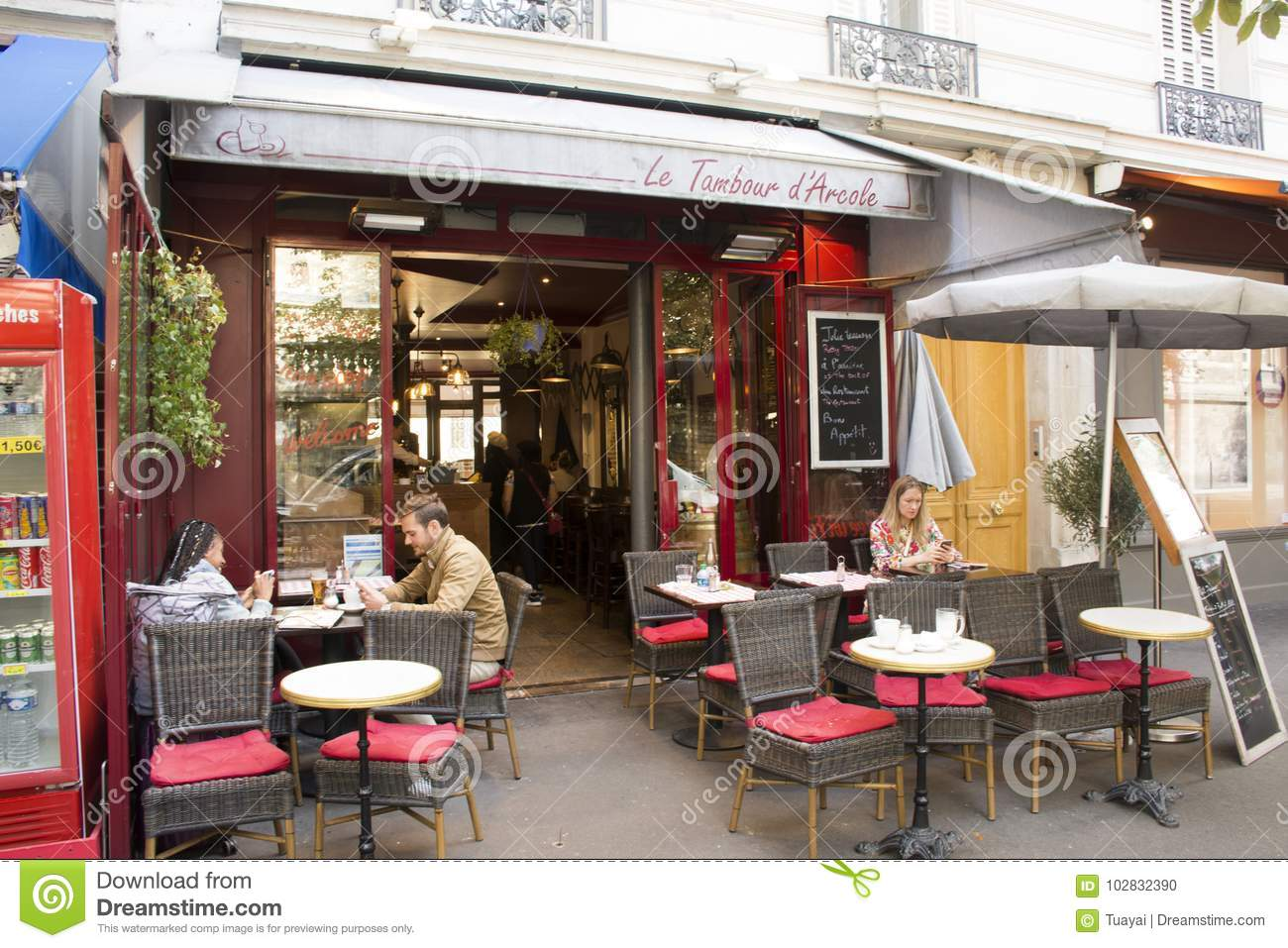 French People And Foreigner Travelers At Restaurant