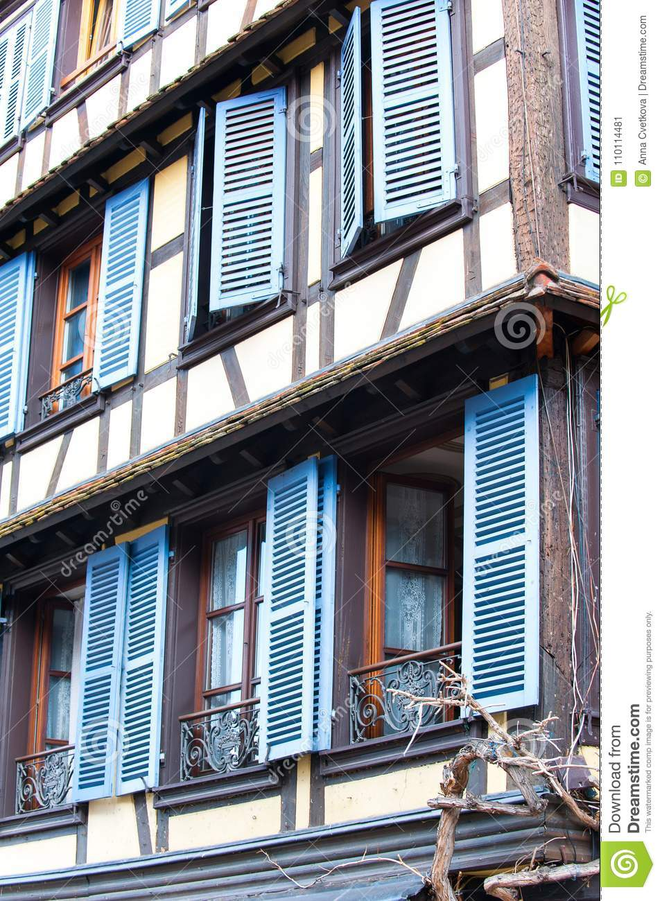 French provencal style windows with blue wooden shutters. Alsace