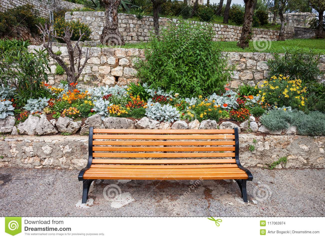 Brilliant French Riviera Garden With Flowers And Bench Stock Photo Lamtechconsult Wood Chair Design Ideas Lamtechconsultcom