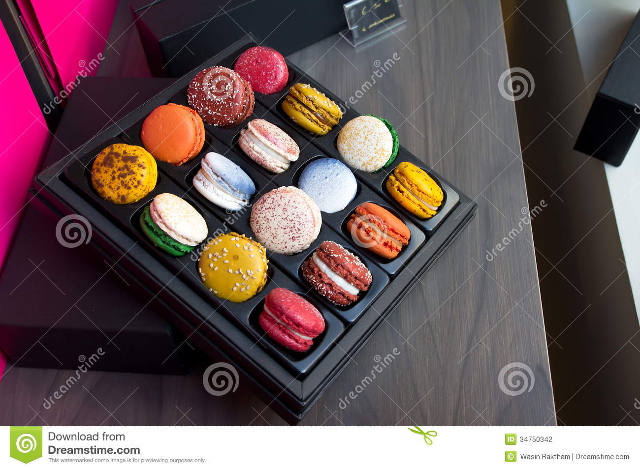 Typical French sandwich cookies, macarons of different flavors in ...