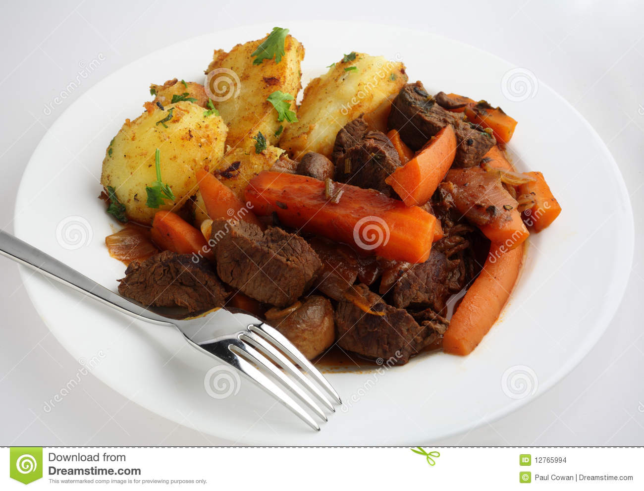 meal of French-style beef and carrot casserole served with sauteed ...