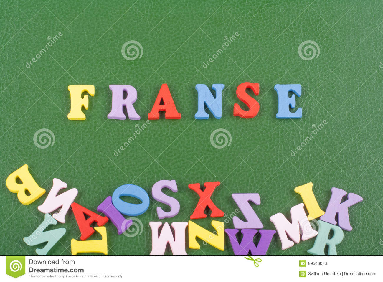 French Word On Green Background Composed From Colorful Abc Alphabet