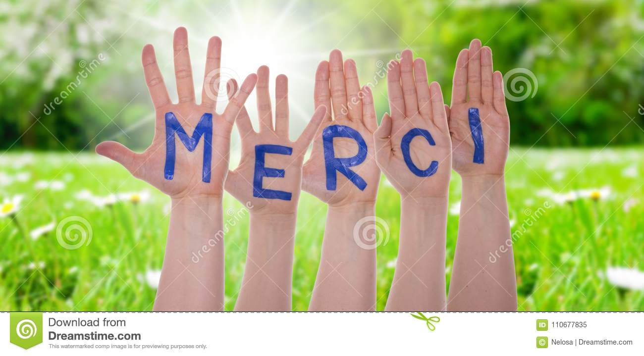 Word Merci Means Thank You On Hands, Sunny Meadow