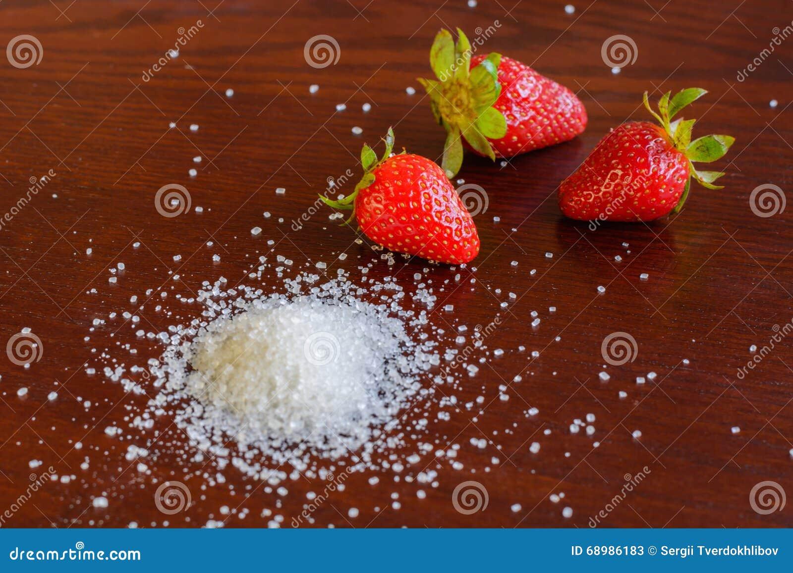 Fresa con el azúcar