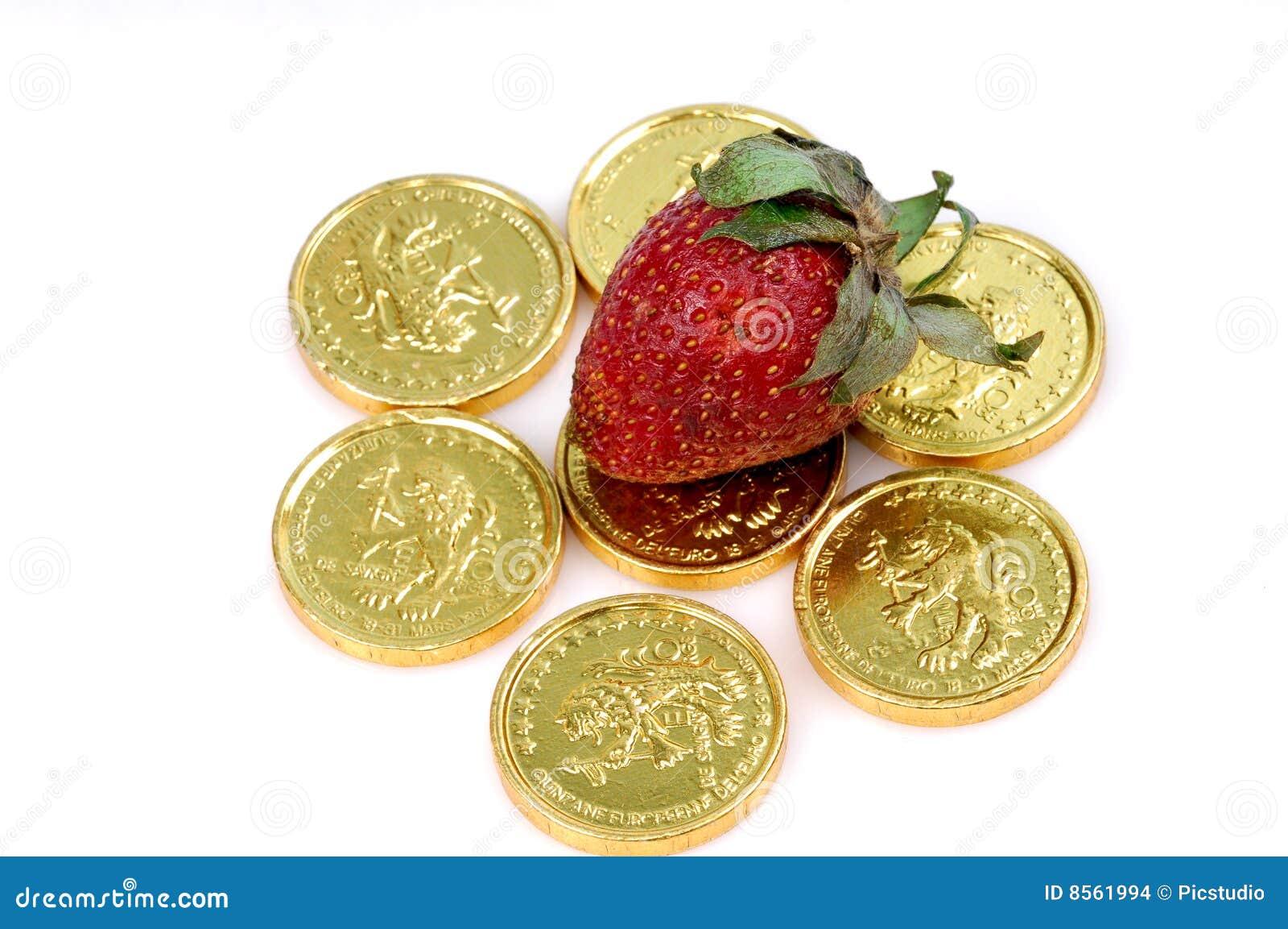 Fresa en monedas de oro
