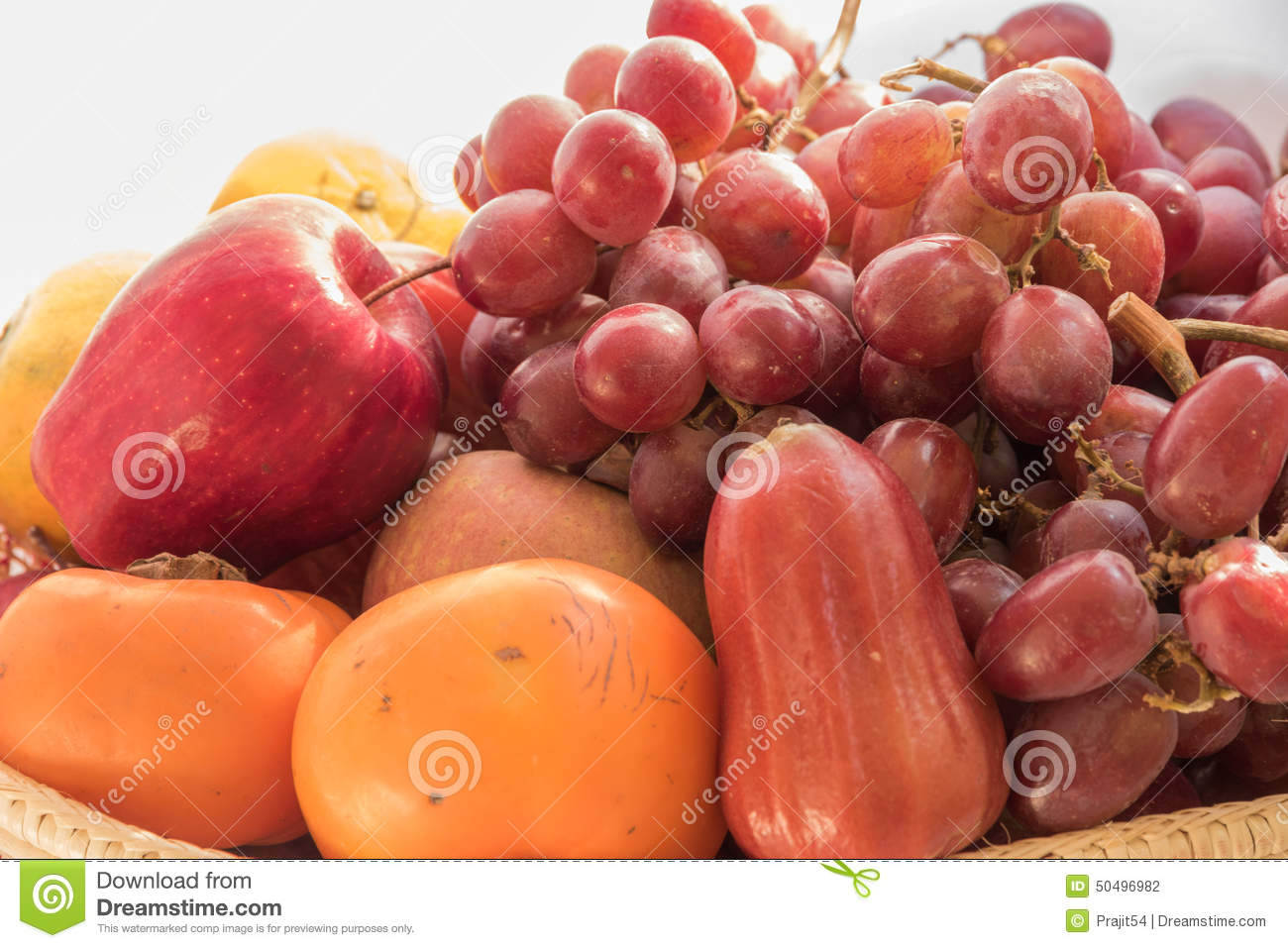 Fresh autumn fruits - rose apple, plums, grapes,orange and apples.