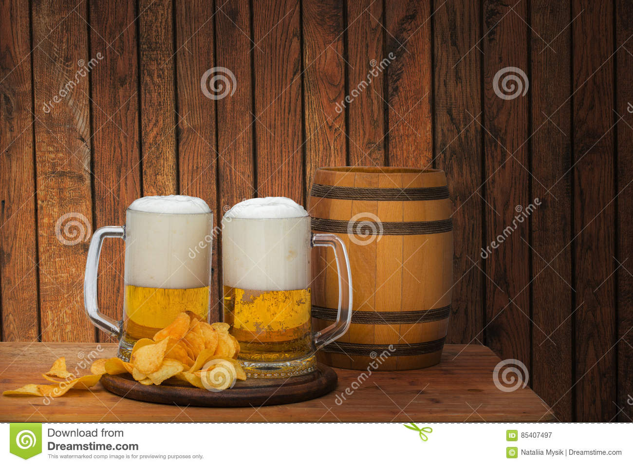 Fresh beer in the glass and chips.