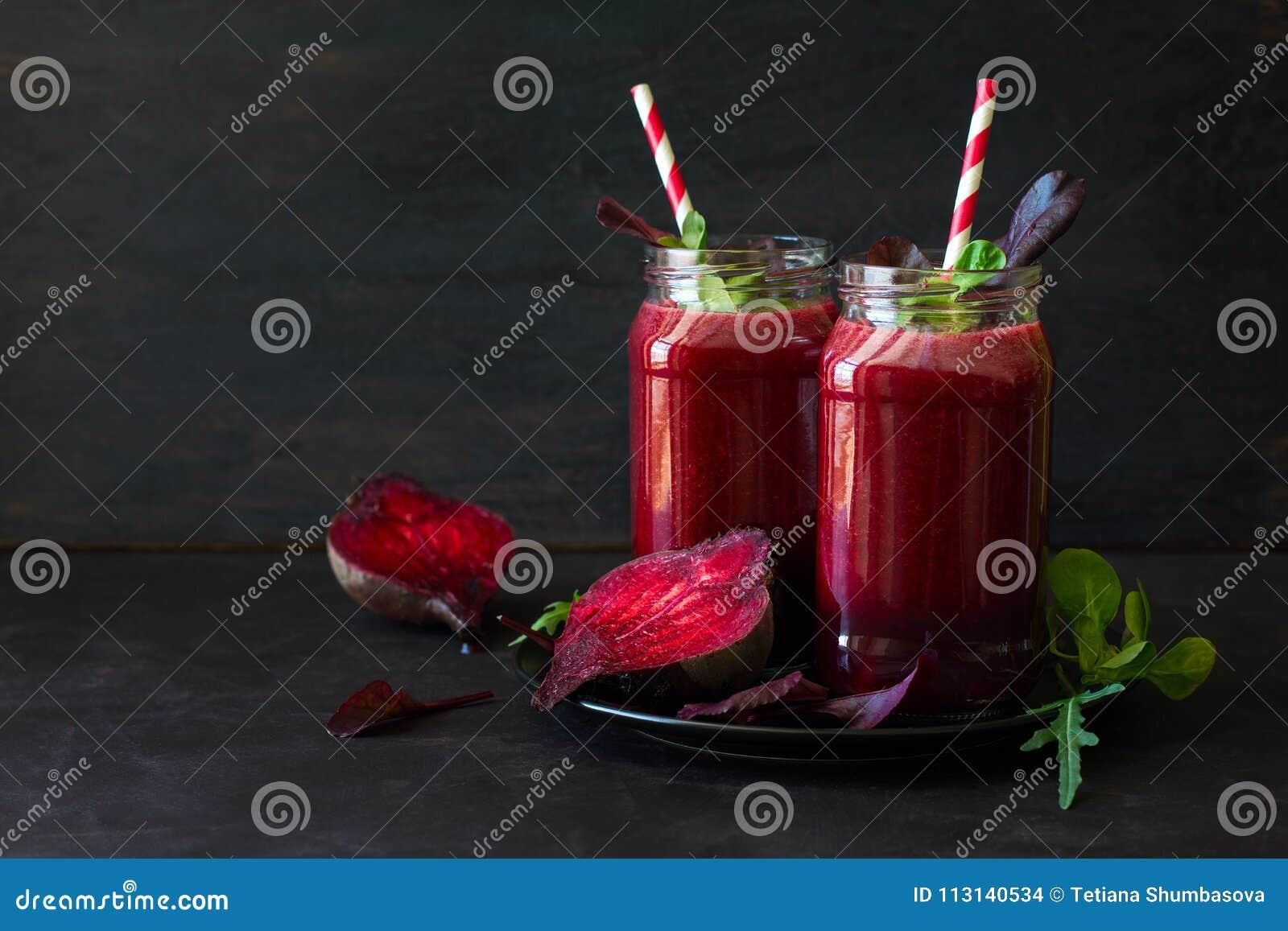 Fresh beetroot smoothie, beet, arugula and lettuce leaves